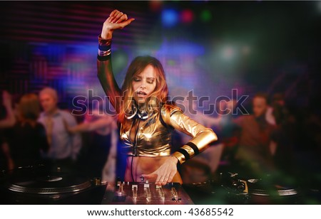 Beautiful DJ girl on decks on the party, - stock photo
