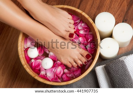 Beautiful female feet at spa salon on pedicure procedure. - stock photo