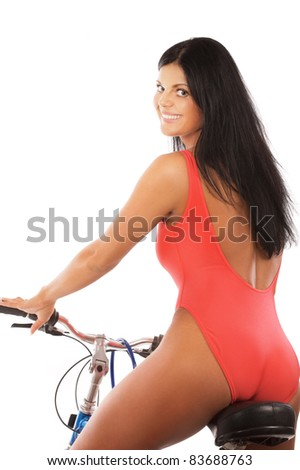 Beautiful fitness woman with bike on white background - stock photo