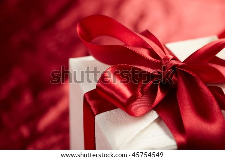 Beautiful gift box on the red background - stock photo