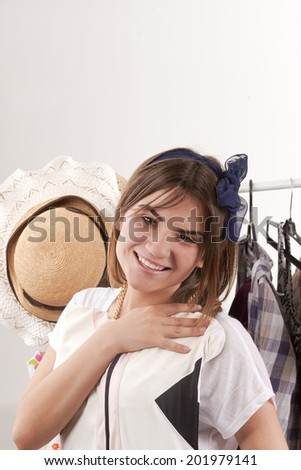 beautiful girl chooses dress - stock photo