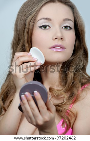 beautiful girl doing make up