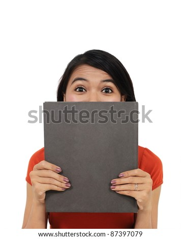 beautiful girl hiding herself behind a book, isolated on white background 2 - stock photo