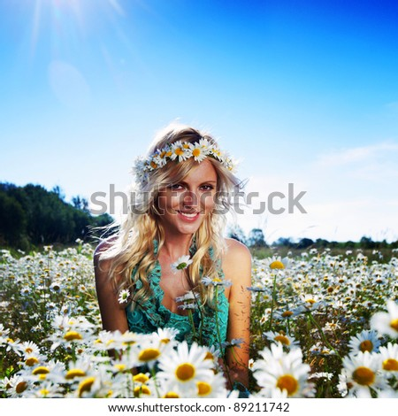 beautiful girl  in dress on the sunny daisy flowers field - stock photo