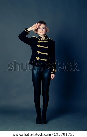 Beautiful girl in the old-fashioned uniform - stock photo