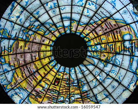Beautiful glass stained-glass window in the form of the globe, bright, colourful, with figure of a planet the ground - stock photo