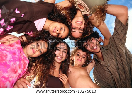 6 Beautiful Happy Children Looking Down at the Viewer - stock photo