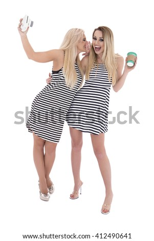 Beautiful happy sexy women in stylish trendy summer outfit posing against white background