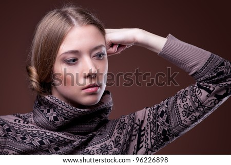 Beautiful happy young woman in a winter sweater - stock photo