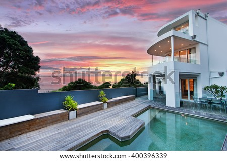 beautiful house with swimming pool in the yard  - stock photo