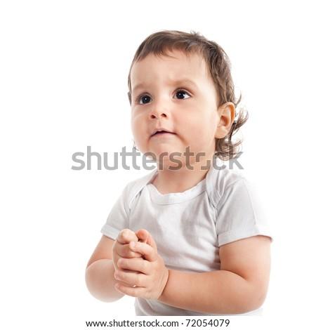beautiful little boy praying isolated on white - stock photo