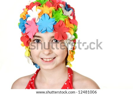Beautiful little girl in a flowered swimming cap - stock photo