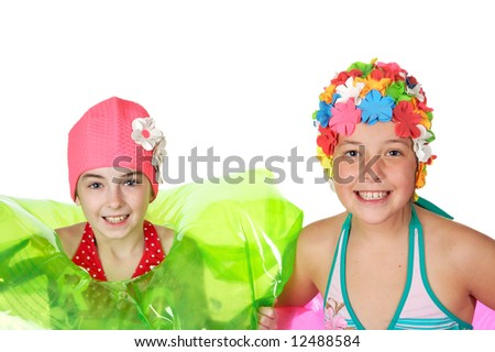 Beautiful little girls in a flowered swim caps - stock photo