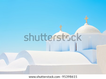 2 Beautiful old white twin churches in Chora the capital of Amorgos island in Greece - stock photo