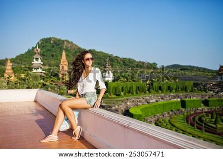 Beautiful pretty young woman walking in a park in Thailand. Pattaya. Nong Nooch Tropical Botanical Garden - stock photo