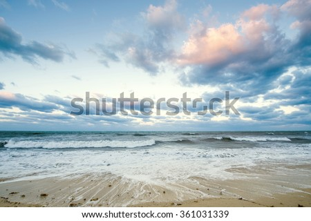 Beautiful sea landscape in early morning mist against the background of dramatic cloudy sky at sun rise time. Cuba coast. - stock photo