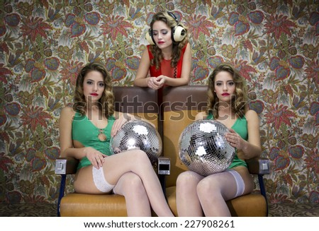 3 beautiful sexy disco women in a bar lounge setting. the model is the same filmed 3 times - stock photo