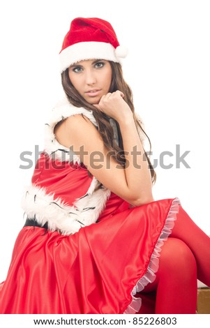 beautiful sexy girl wearing santa claus clothes, isolated on white background - stock photo