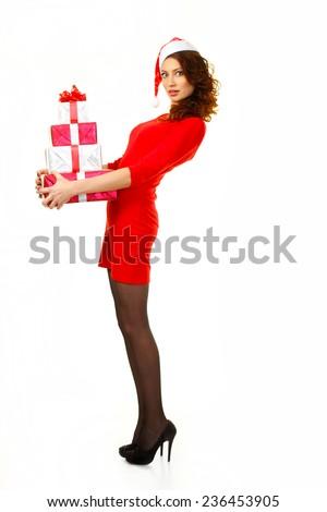 beautiful sexy girl wearing santa  clothes. Emotional santa Girl rejoices Santa gifts - stock photo