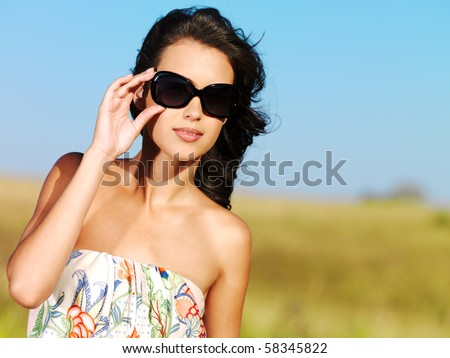 beautiful sexy woman on the nature in black sunglasses - stock photo