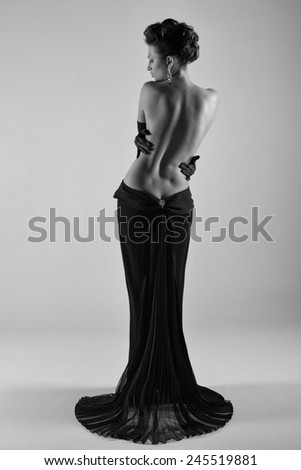 Beautiful silhouette of a woman with bare back - stock photo