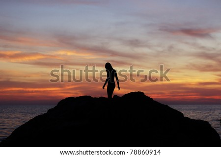 beautiful silhouette of girl on sunset