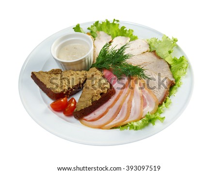 Beautiful slice meat arrangement with some vegetables. Shallow depth-of-field.