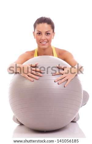 beautiful sport woman hugging big gray ball