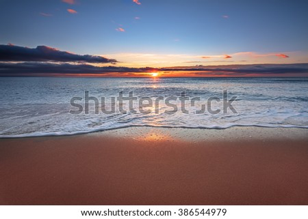 Beautiful tropical sunrise on the beach. - stock photo
