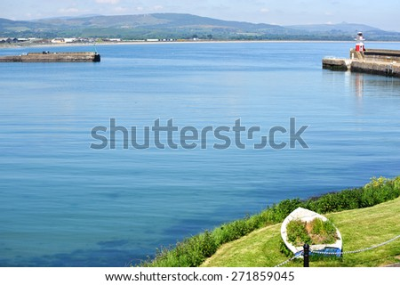 Beautiful view on summer harbour and lighthouse in Wicklow town, Ireland - stock photo