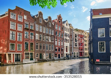 """Beautiful views of the streets, ancient buildings, people, embankments of Amsterdam - also call """"Venice in the North"""". Netherland - stock photo"""