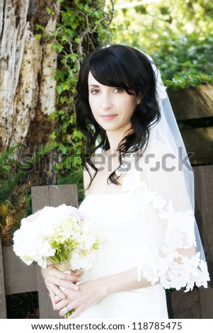 Beautiful wedding bride in white with lacy  veil - stock photo