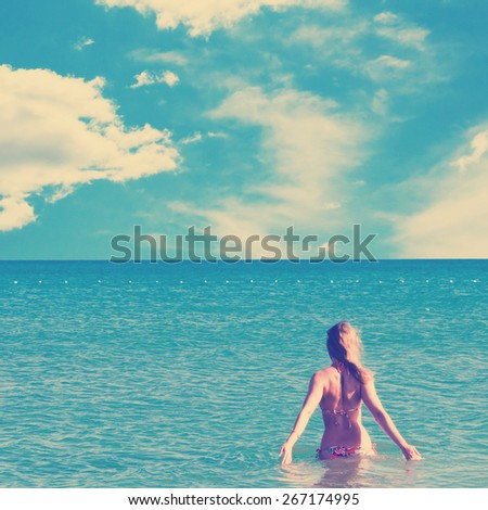 beautiful woman and sea. Instagram style filtred image - stock photo