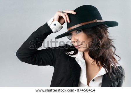 Beautiful woman in cowboy hat. - stock photo