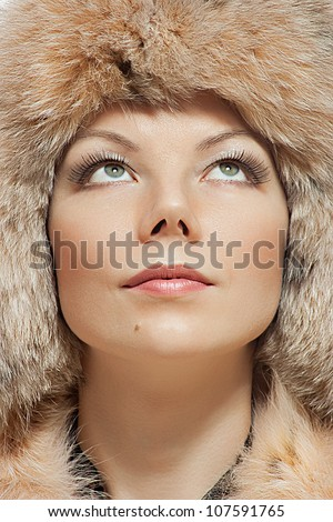 Beautiful woman in fur hat