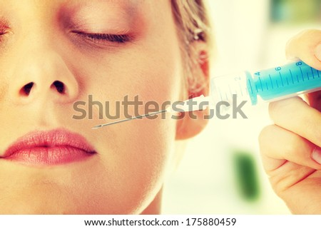 Beautiful woman recieving an injection - stock photo