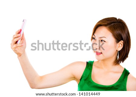 Beautiful woman smiling being happy taking picture of herself using mobile phone.   - stock photo