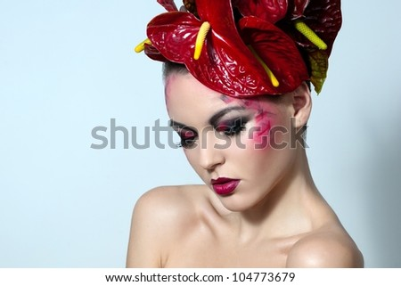 Beautiful woman with anthurium flower - stock photo