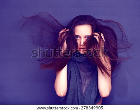 ???????? ??????????: Beautiful woman with long brown hair. Closeup portrait of a fashion model posing at studio. - stock photo