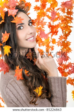 beautiful woman with orange leaves around her
