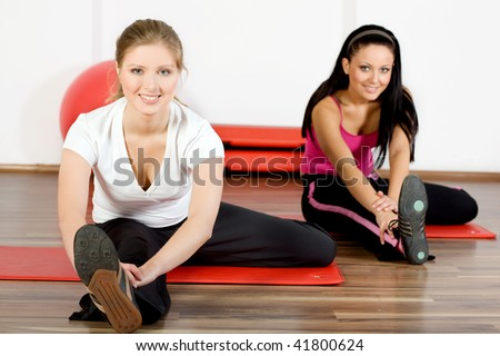 ?Beautiful women exercising in fitness club - stock photo