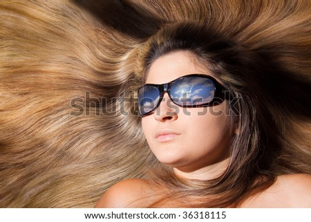 beautiful women in glasses looking to the blue sky - stock photo