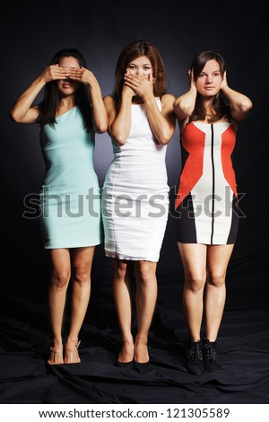 Beautiful women is making pose like three monkeys,no evil monkeys. - stock photo