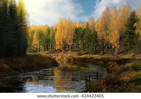 Beautiful yellow autumn on a calm river - stock photo