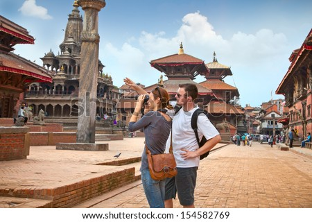 Beautiful young couple at Durbar Sqaure in Patan, Lalitpur city, Nepal - stock photo