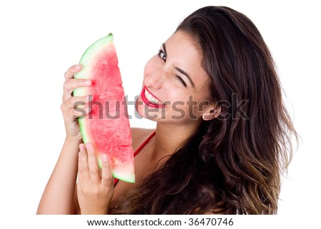 Beautiful young girl eating watermelon with joy. isolated on white - stock photo