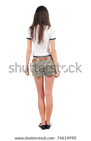 Beautiful young woman in shorts looking at wall. Rear view. Isolated over white. - stock photo