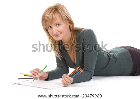 Beautiful young woman is going to draw. Isolated over white.