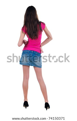 Beautiful young woman looking at wall. Rear view. Isolated over white.