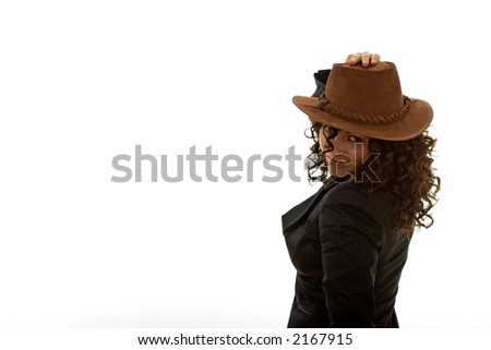 Beautiful young woman wearing a cowboy hat posing against a white background